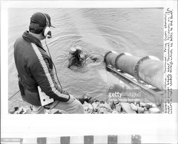 Tocumwar Police Driver searching river at Pumps bead near Tocumwar Policeman on left wear a radio ***** through which he talks to the driver June 18...