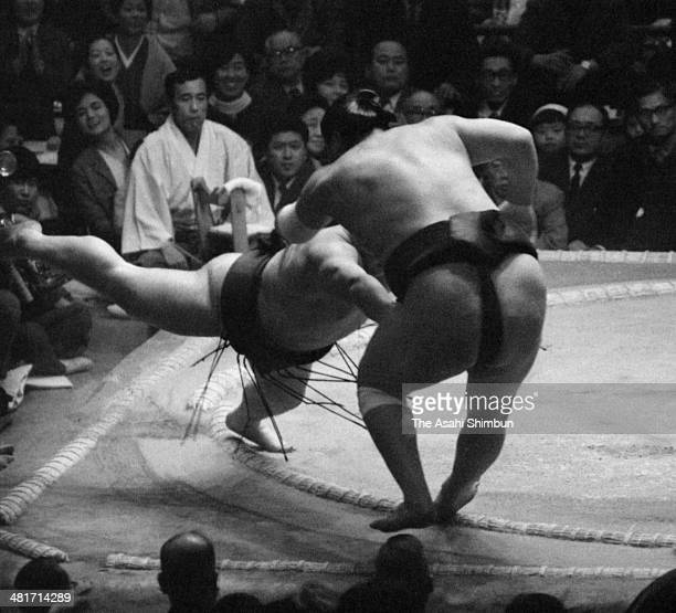 Toda pushes out yokozuna Taiho to win during day two of the Grand Sumo Spring Tournament at Osaka Prefecture Gymnasium on March 10 1969 in Osaka...