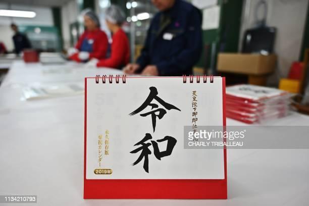 Todan employees pack calendars bearing Japan's next imperial era name Reiwa at a production plant in Ibaraki on April 1 2019 Reiwa Japan on April 1...