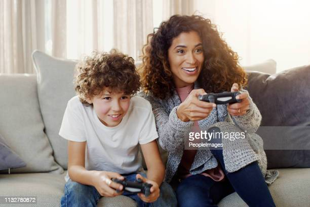 today is game day with my little champ - leisure games stock pictures, royalty-free photos & images
