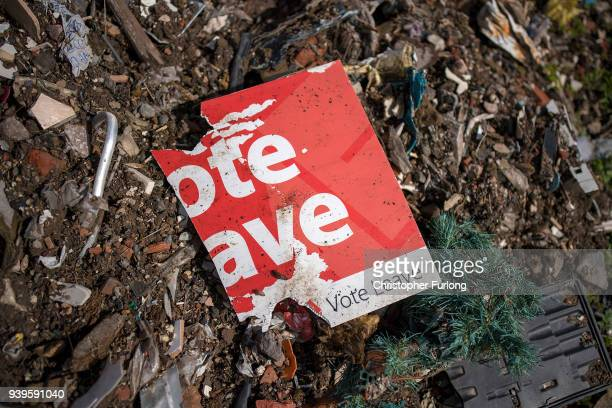 Today marks the oneyear countdown to Brexit and a discarded and weather beaten 'Vote Leave' placard decays on a pile of rubbish next to the road in...