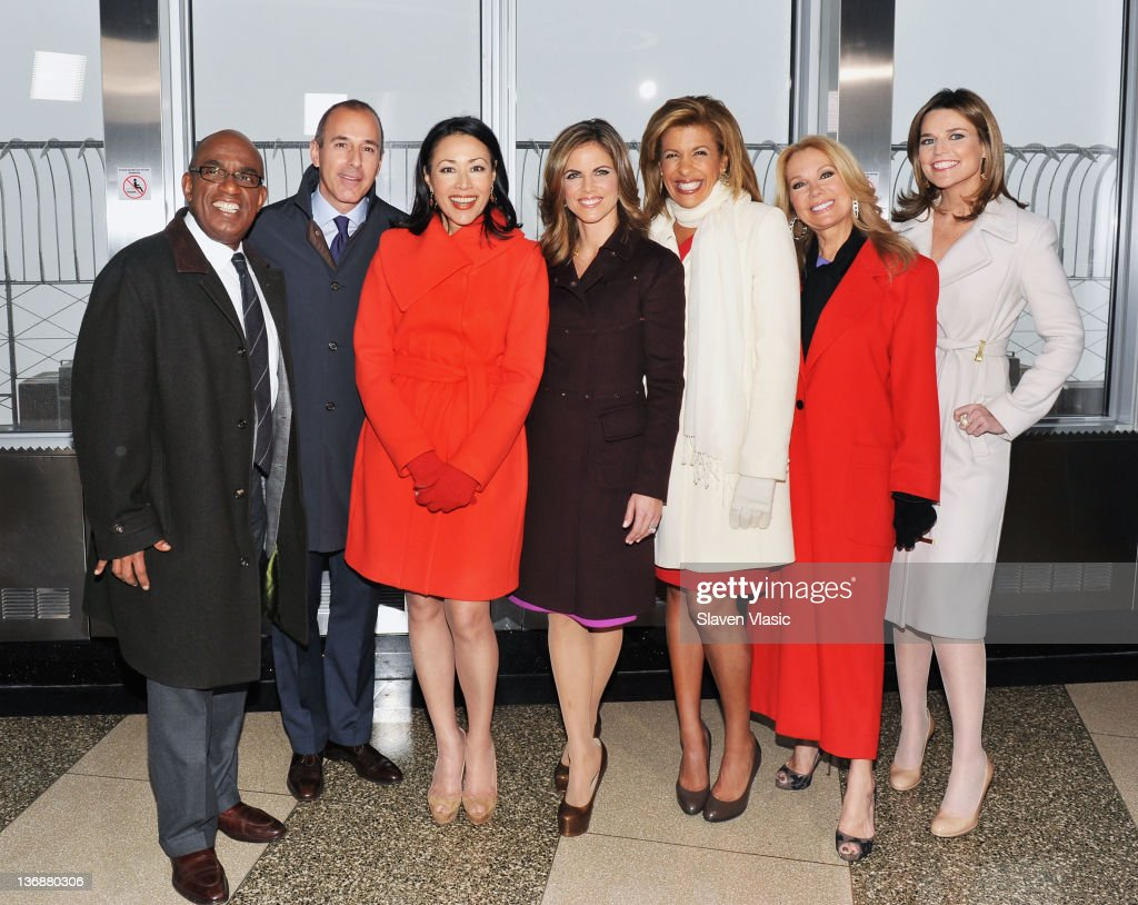 Today Show anchors Al Roker, Matt Lauer, Ann Curry, Natalie Morales, Hoda Kotb, Kathie Lee Gifford and Savannah Guthrie pose for pictures at The Empire State Building in honor of the 60th Anniversary of 'Today' on January 12, 2012 in New York City.