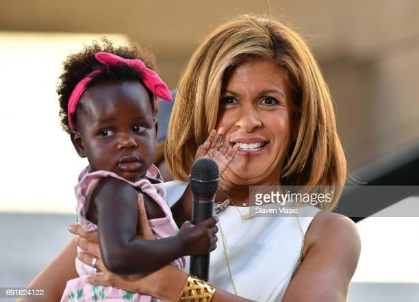 Today Show host Hoda Kotb holds Thomas Rhett's daughter Willa Gray during Thomas Rhett's performance on NBC's Today at Rockefeller Plaza on June 2...