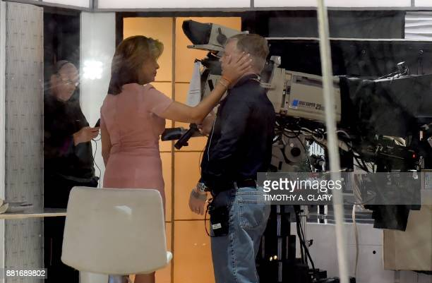 NBC Today Show host Hoda Kotb speaks with a studio cameraman at the end of the morning Today show segment on November 29 after it was announced Matt...