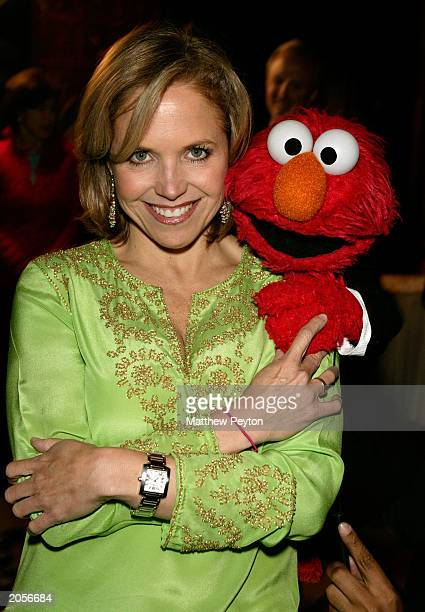Today Show host Katie Couric and Muppet Elmo attend the Sesame Street Workshop 35th Anniversary Gala at Cipriani June 4, 2003 in New York City.