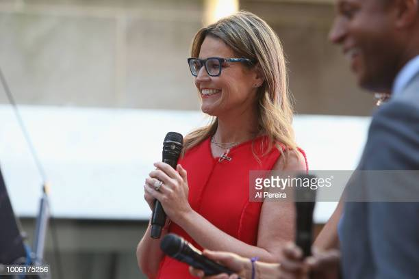 'Today' Show host Savannah Guthrie follows the action while wearaing her glasses when Julia Michaels performs on NBC's 'Today Show' at Rockefeller...