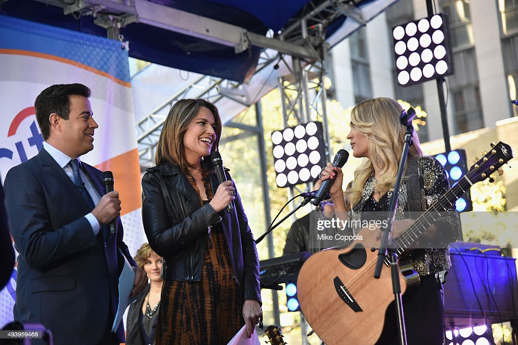 Today show hosts Carson Daly and Savannah Guthrie speak with Carrie Underwood onstage during the Carrie Underwood performance on the Citi Concert Series On Today in Rockefeller Plaza on October 23, 2015 in New York City.