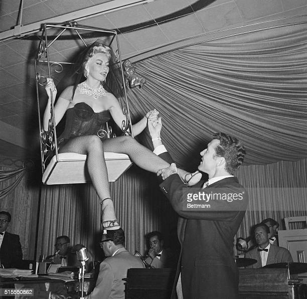 Today was to have been the wedding day of Lili St Cyr blonde strip tease dancer and Ted Jordan an actor shown helping her from her cage after one of...