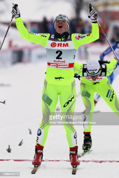 Today's winner Vesna Fabjan of Slovenia celebrates her victory in the women's individual sprint of the FIS World Cup Cross Country on February 5 2011...