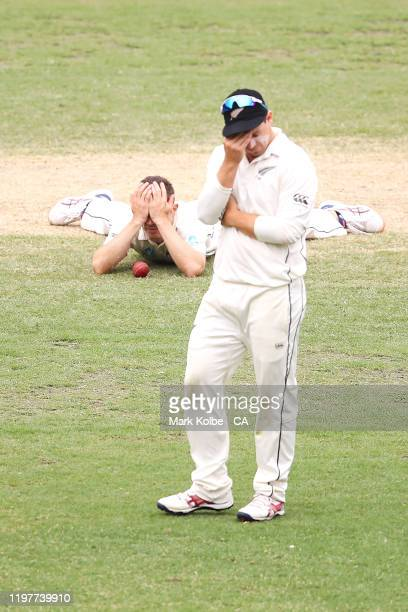 Todd Astle and Tom Latham of New Zealand look dejected after Astle dropped Marnus Labuschagne of Australia during day four of the Third Test Match in...