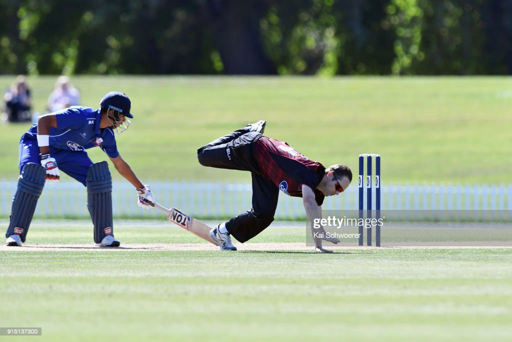 Todd Astle of Canterbury fields the ball off his own bowling during the One Day Ford Trophy Cup match between Canterbury and Auckland on February 7, 2018 in Christchurch, New Zealand.