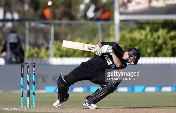 TOPSHOT Todd Astle of New Zealand avoids a bouncer during the first ODI cricket match between New Zealand and the West Indies at Cobham Oval in...