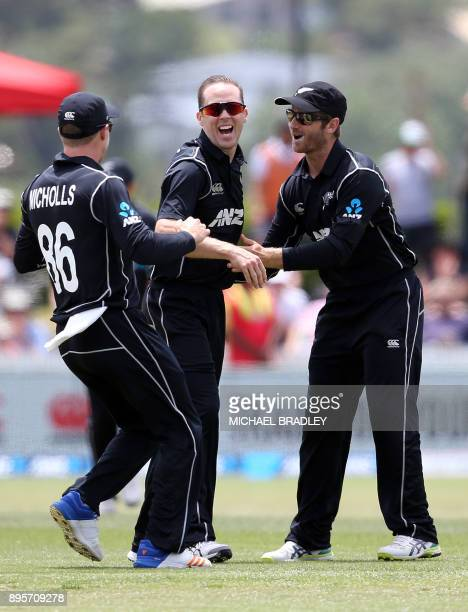 Todd Astle of New Zealand celebrates the wicket of West Indies Shimron Hetmyer during the first ODI cricket match between New Zealand and the West...