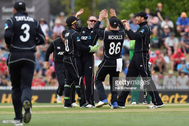Todd Astle of New Zealand is congratulated by team mates after dismissing Sarfraz Ahmed of Pakistan during the second match in the One Day...