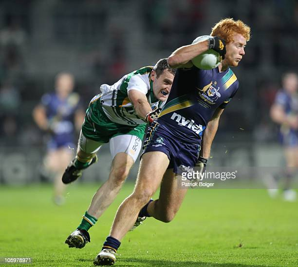 Todd Banfield of Australia and Graham Canty of Ireland in action during the International Rules series First Test between Ireland and Australia at...