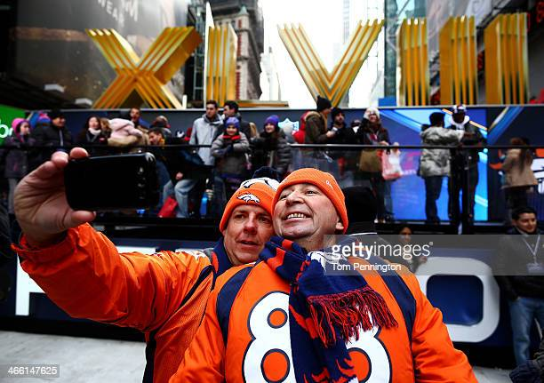 Todd Barnes and Mitch Daniels photograph themselves on Super Bowl Boulevard in Times Square prior to Super Bowl XLVIII on January 31, 2014 in New...