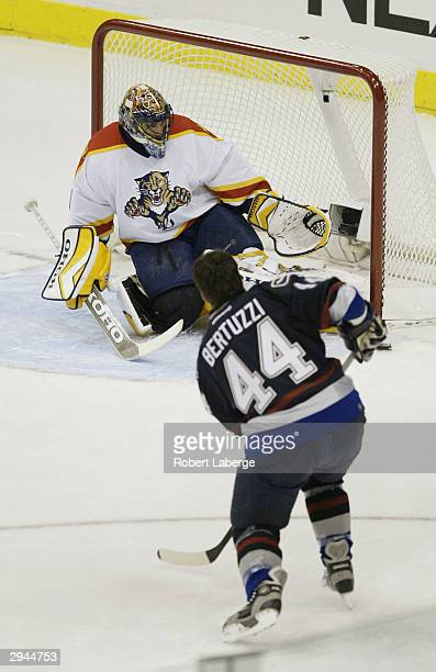 Todd Bartuzzi of the Vancouver Canucks takes a shot against Roberto Luongo of the Florida Panthers during the In The Zone competition in the NHL...