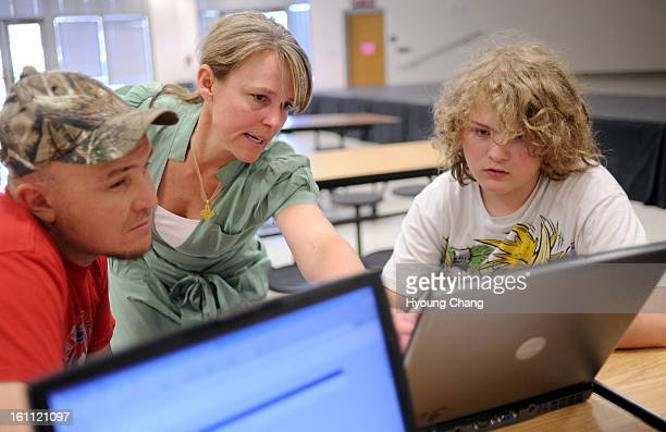 Todd Bennett left and his son Wesley right are registering for collegeincoloradoorg web site with the help of counselor De Allen of Jefferson County...