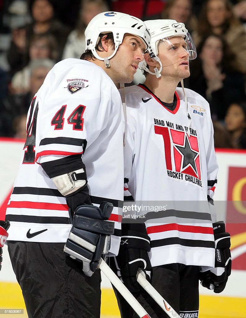 Todd Bertuzzi #44 and Markus Naslund #19 of the Vancouver Canucks talk as they stand on the ice during the Brad May and Friends Hockey Challenge at the Pacific Coliseum on December 12, 2004 in Vancouver, Canada. Players from the NHL and the WHL Vancouver Giants played two exhibition games to raise money for Canuck Place hospice in Vancouver. Tonight was the first game Todd Bertuzzi has played in since he was suspended last season for punching Steve Moore. Photo by Jeff Vinnick/Getty Images)