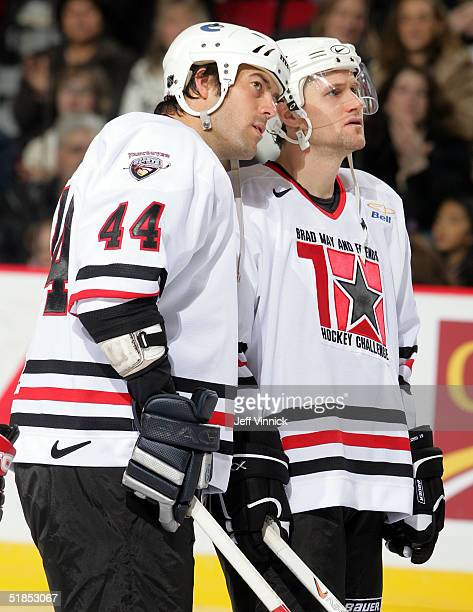 Todd Bertuzzi and Markus Naslund of the Vancouver Canucks talk as they stand on the ice during the Brad May and Friends Hockey Challenge at the...