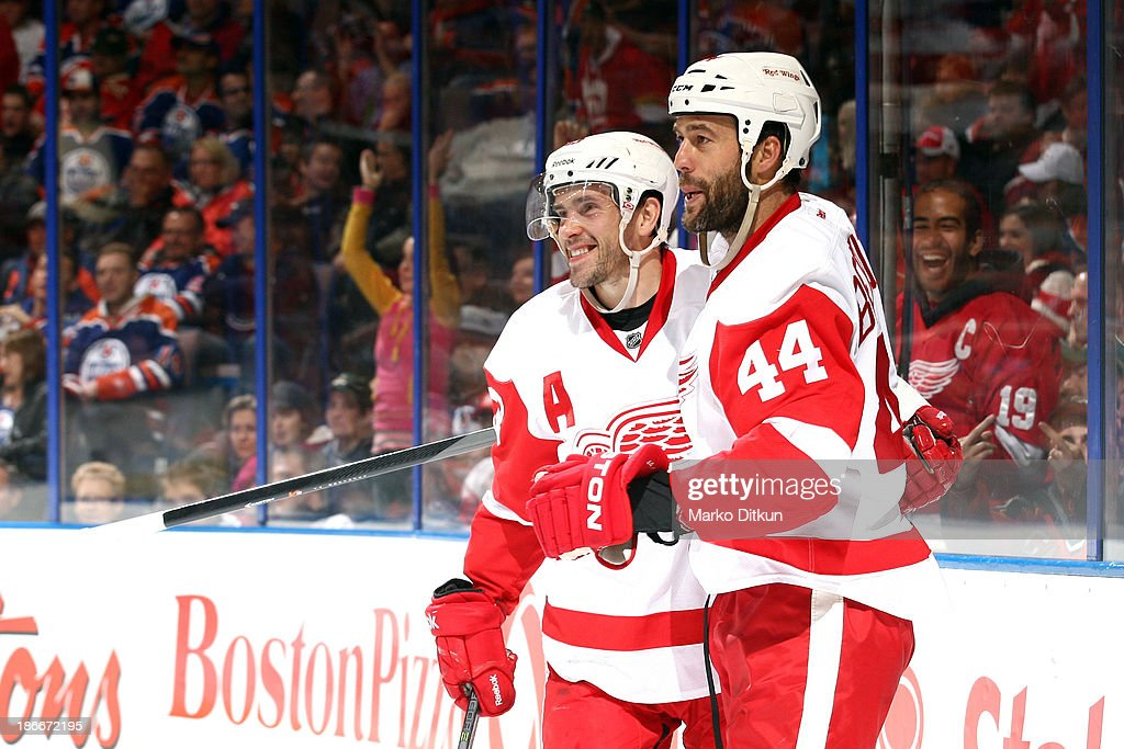 Todd Bertuzzi #44 and Pavel Datsyuk #13 of the Detroit Red Wings celebrate after a goal in a game against the Edmonton Oilers on November 2, 2013 at Rexall Place in Edmonton, Alberta, Canada.