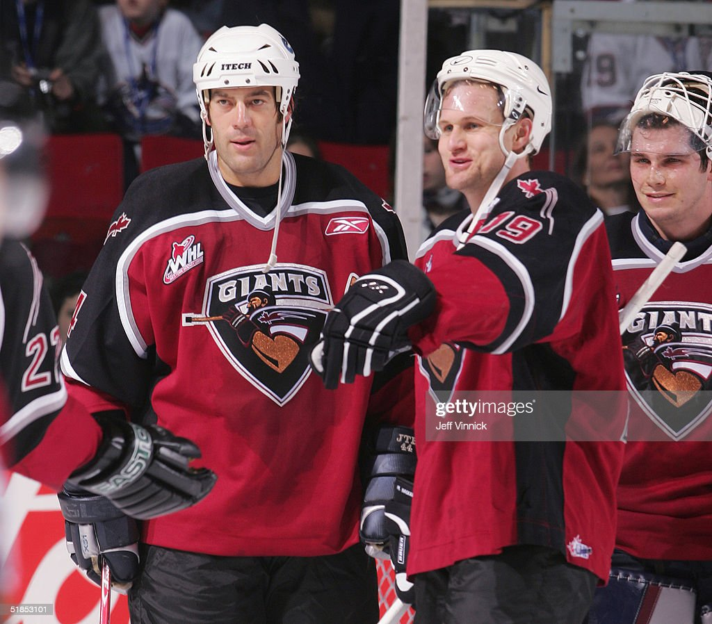 Todd Bertuzzi #44, Markus Naslund #19 and Dan Cloutier #39 of the Vancouver Canucks stand on the ice during the Brad May and Friends Hockey Challenge at the Pacific Coliseum on December 12, 2004 in Vancouver, Canada. Players from the NHL and the WHL Vancouver Giants played two exhibition games to raise money for Canuck Place hospice in Vancouver. Tonight was the first game Todd Bertuzzi has played in since he was suspended last season for punching Steve Moore.