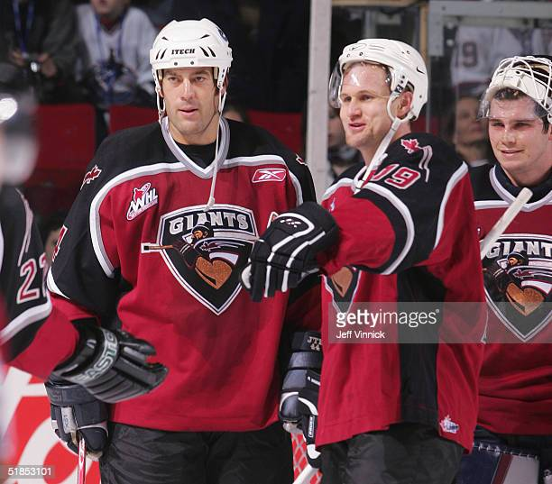 Todd Bertuzzi Markus Naslund and Dan Cloutier of the Vancouver Canucks stand on the ice during the Brad May and Friends Hockey Challenge at the...