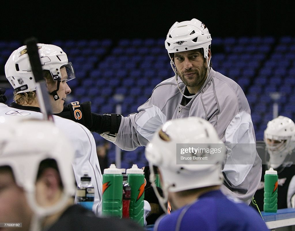 Todd Bertuzzi of the Anaheim Ducks chats with teammates during practice on September 26, 2007 at the O2 arena in London, England.