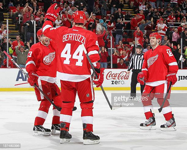 Todd Bertuzzi of the Detroit Red Wings celebrates his goal with teammate Ian White and Pavel Datsyuk during an NHL game against the Buffalo Sabres at...