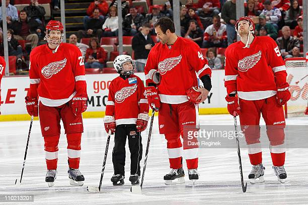 Todd Bertuzzi of the Detroit Red Wings stands for the National Anthem next to his son Tag Bertuzzi and between teammates Brad Stuart and Niklas...