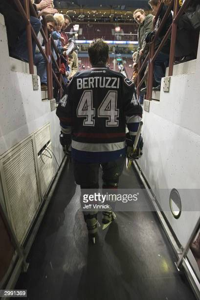 Todd Bertuzzi of the Vancouver Canucks is greeted by fans as he makes his way to the ice rink prior to the game against the Dallas Stars at General...