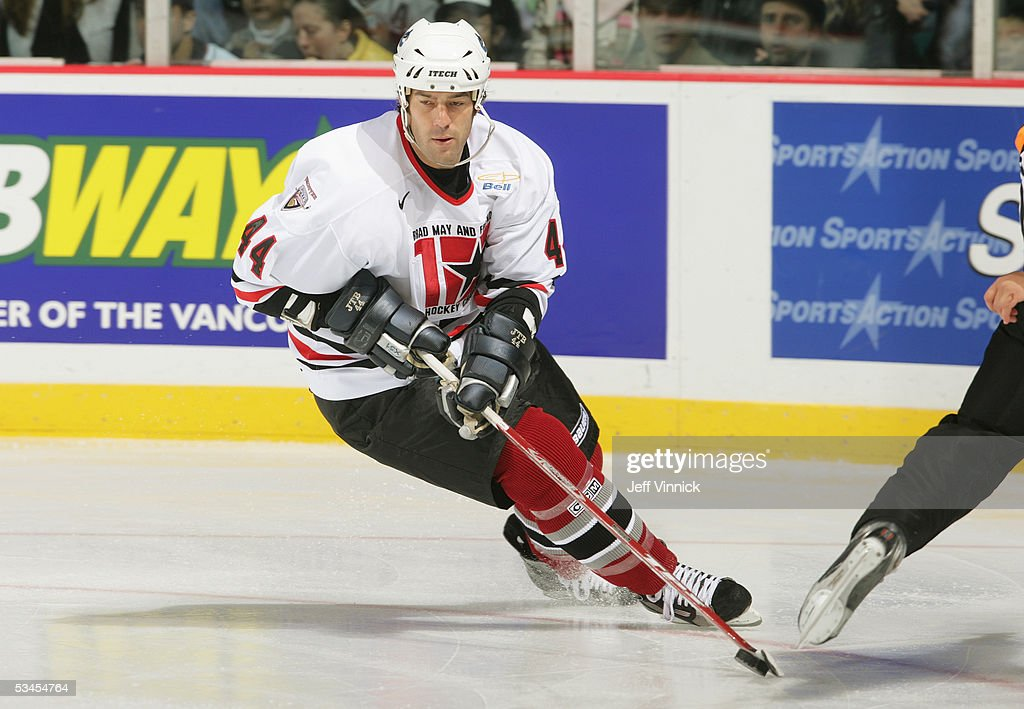 Todd Bertuzzi #44 skates with the puck during the Brad May and Friends Hockey Challenge at the Pacific Coliseum on December 12, 2004 in Vancouver, Canada. Players from the NHL and the WHL Vancouver Giants played two exhibition games to raise money for Canuck Place hospice in Vancouver.