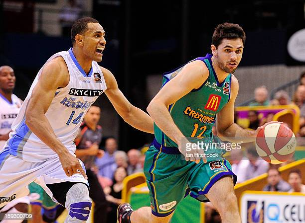 Todd Blachfield of the Crocodiles drives to the basket past Mika Vukona of the Breakers during the round 14 NBL match between the TOwnsville...