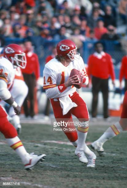 Todd Blackledge of the Kansas City Chiefs drops back to pass against the Denver Broncos during an NFL football game December 14 1985 at Mile High...