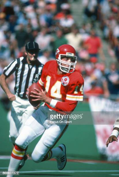 Todd Blackledge of the Kansas City Chiefs rolls out to pass during an NFL football game circa 1984 at Arrowhead Stadium in Kansas City Missouri...