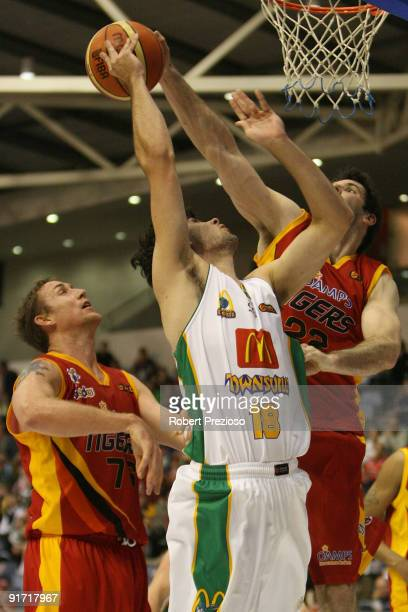 Todd Blanchfield of the Crocodiles gathers the basketball during the round three NBL match between the Melbourne Tigers and the Townsville Crocodiles...
