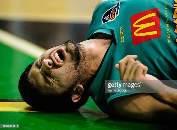 Todd Blanchfield of the Crocodiles grimaces in pain after being injured during the round 20 NBL match between the Townsville Crocodiles and the...
