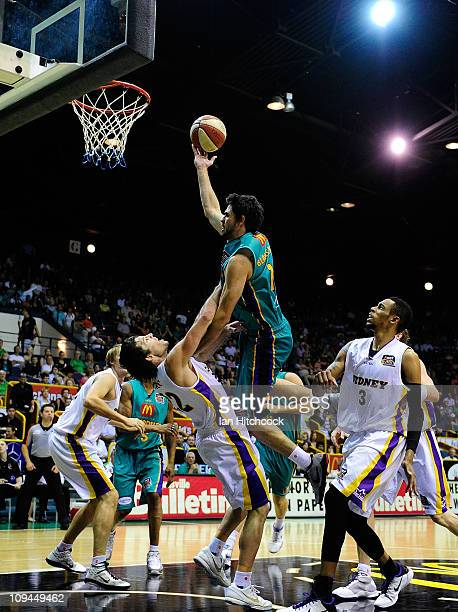 Todd Blanchfield of the Crocodiles makes a layup over Kevin White of the Kings just before being injured when he fell to the floor during the round...