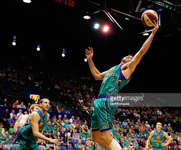 Todd Blanchfield of the Crocodiles regathers a rebound during the round four NBL match between the Townsville Crocodiles and the Sydney Kings at...