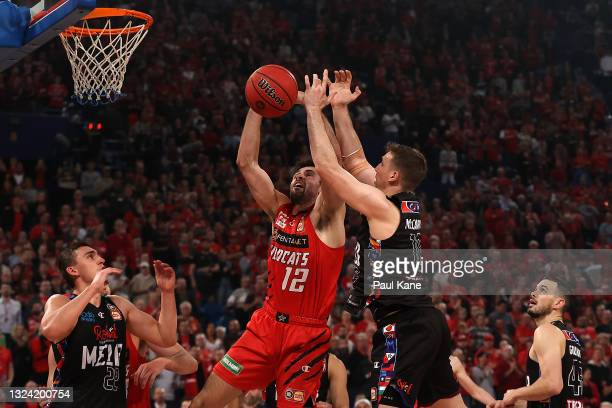 Todd Blanchfield of the Wildcats and Mitch McCarron of Melbourne United contest for a rebound during game one of the NBL Grand Final Series between...