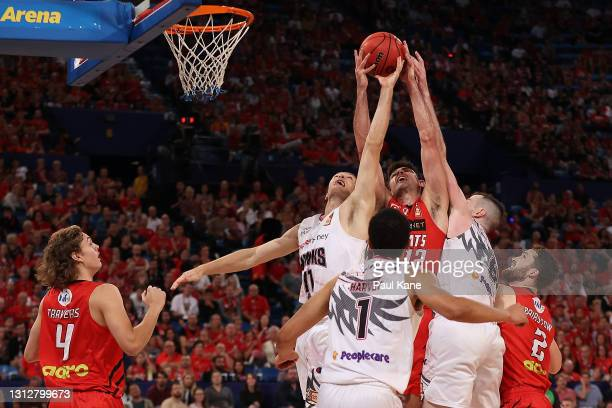 Todd Blanchfield of the Wildcats contests for a rebound against Daniel Grida and Andrew Ogilvy of the Hawks during the round 14 NBL match between the...