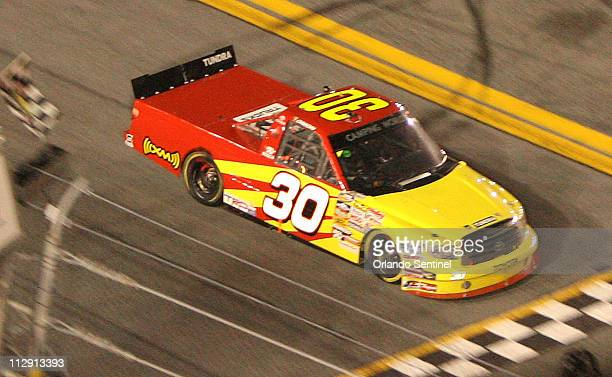 Todd Bodine crosses the finish line to win the NextEra Energy Resources 250 truck race at Daytona International Speedway on Friday evening February...