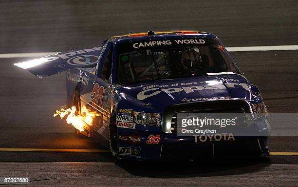 Todd Bodine driver of the Copartcom Toyota refires his truck after crashing during the NASCAR Camping World Series North Carolina Education Lottery...