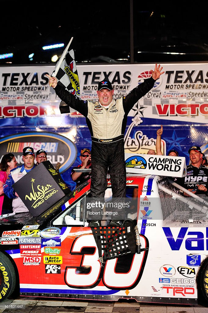 Todd Bodine, driver of the #30 Germain.com Toyota, celebrates in victory lane after winning the NASCAR Camping World Truck Series WinStar World Casino 400k at Texas Motor Speedway June 4, 2010 in Fort Worth, Texas.