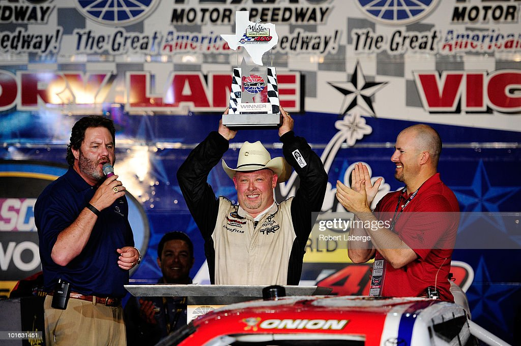 Todd Bodine, driver of the #30 Germain.com Toyota, celebrates in victory lane with Texas Motor Speedway President Eddie Gossage (L) after winning the NASCAR Camping World Truck Series WinStar World Casino 400k at Texas Motor Speedway June 4, 2010 in Fort Worth, Texas.