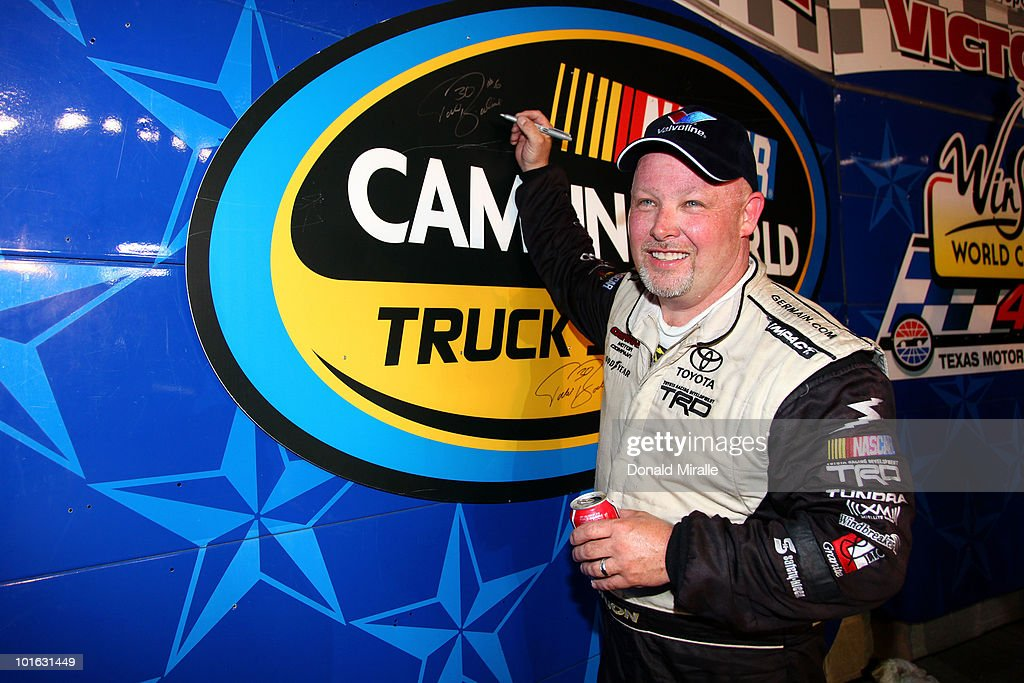 Todd Bodine, driver of the #30 Germain.com Toyota, signs the wall in victory lane after winning the NASCAR Camping World Truck Series WinStar World Casino 400k at Texas Motor Speedway June 4, 2010 in Fort Worth, Texas.