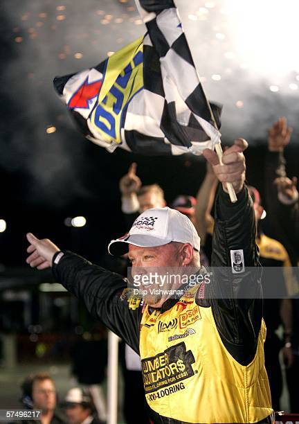 Todd Bodine driver of the Lumber Liquidators Toyota celebrates his victory at the Dodge Ram Tough 200 April 29 2006 at Gateway International Raceway...