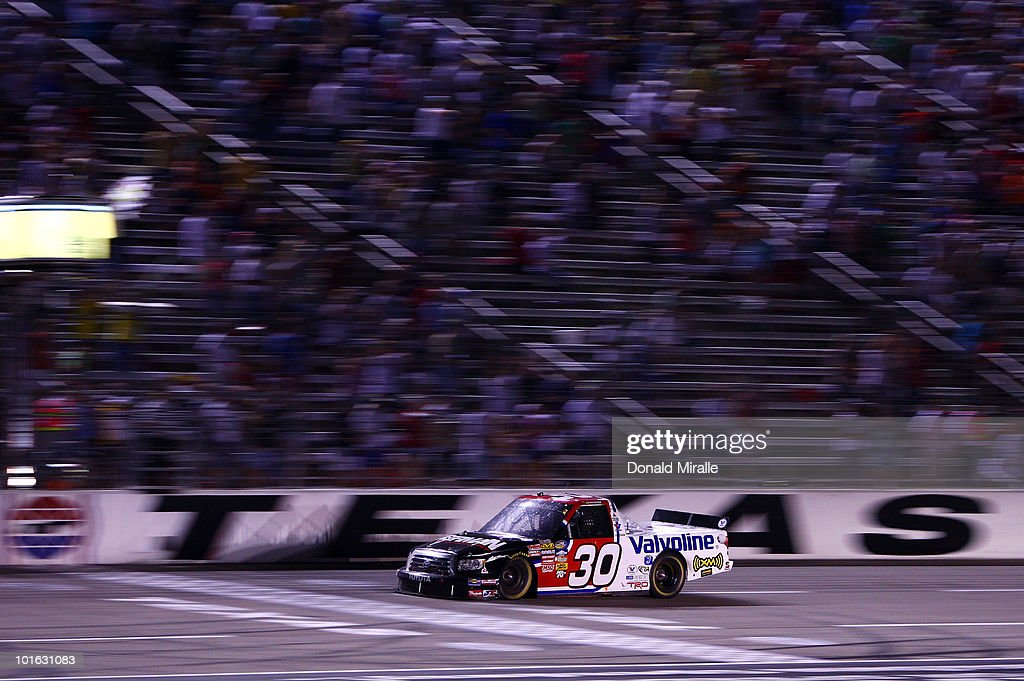 Todd Bodine drives the #30 Germain.com Toyota across the finish line to win the NASCAR Camping World Truck Series WinStar World Casino 400k at Texas Motor Speedway June 4, 2010 in Fort Worth, Texas.