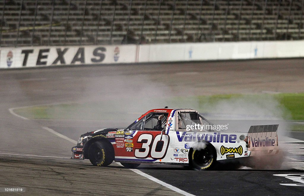 Todd Bodine performs a burnout in the #30 Germain.com Toyota after winning the NASCAR Camping World Truck Series WinStar World Casino 400k at Texas Motor Speedway June 4, 2010 in Fort Worth, Texas.