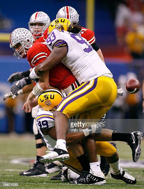 Todd Boeckman of the Ohio State Buckeyes loses the ball as he is wrapped by Tyson Jackson of the Louisiana State University Tigers and Kirston...